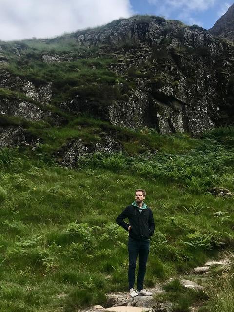 Rens standing in green meadow.
