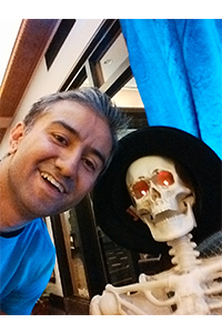 Mohammad with a Halloween skeleton.