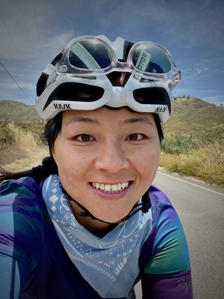 Su Lei riding a bicycle.