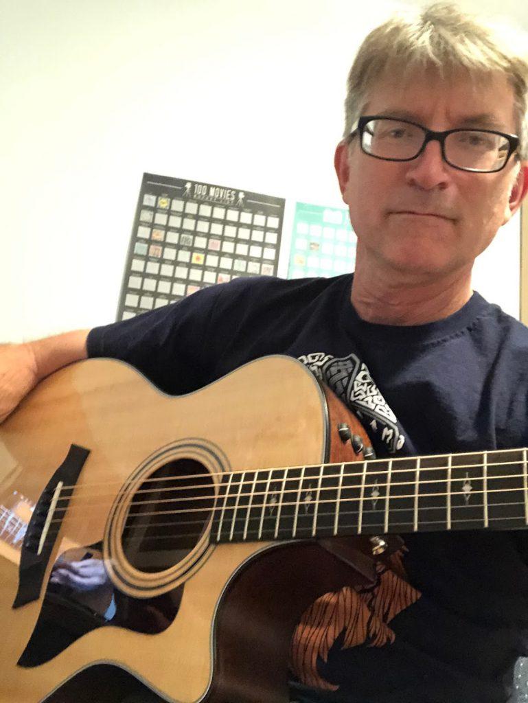 Jon Gratch playing the guitar.
