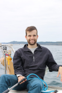 Young man sailing off the coast of northern Brittany.